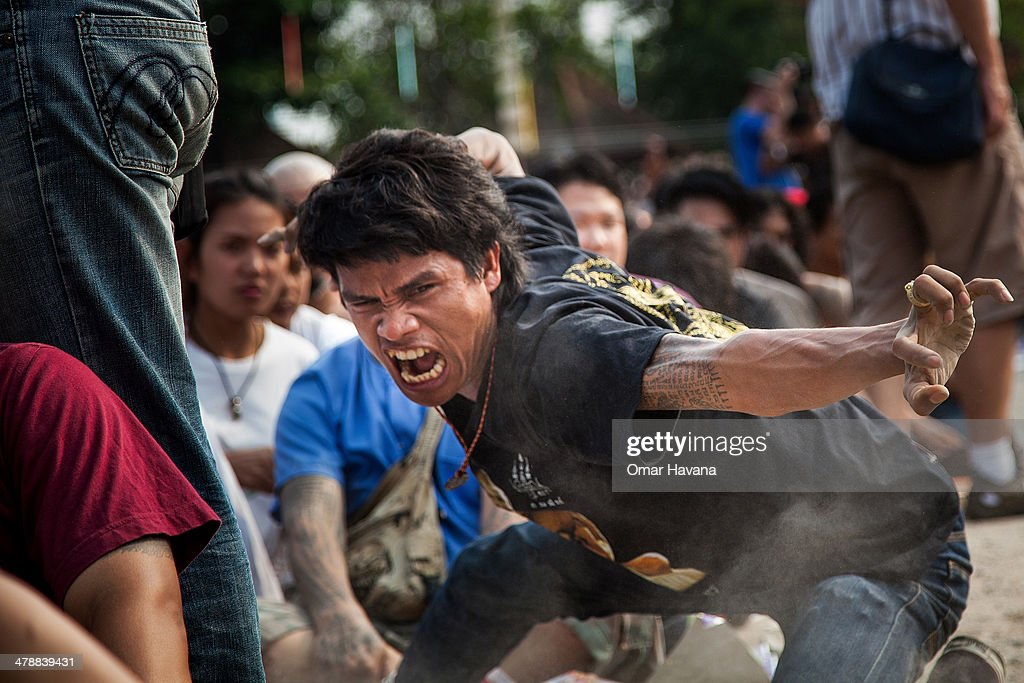 Thai devotee reportedly possessed by spirits growls during the celebration of the annual Tattoo festival at Wat Bang Phra on March 15 2014 in Nakhon...
