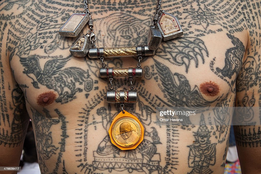Thai devotees shows his body tattoos during the celebration of the annual Tattoo festival at Wat Bang Phra on March 15 2014 in Nakhon Pathom Thailand...