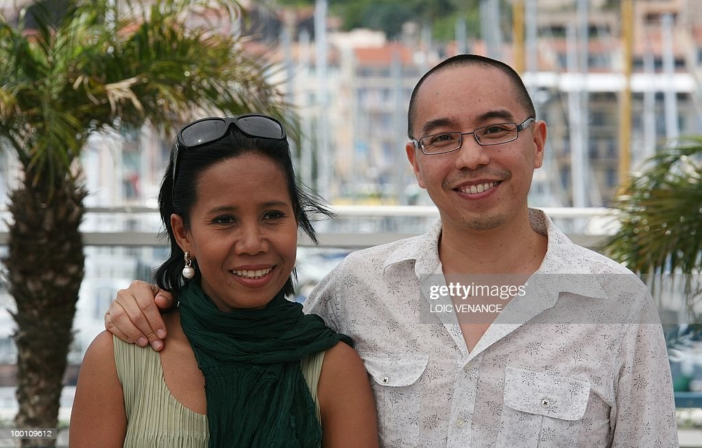 Thai director Apichatpong Weerasethakul and Thai actress Wallapa Mongkolprasert pose during the photocall 'Lung Boonmee Raluek Chat' (Uncle Boonmee Who Can Recall His Past Lives) presented in competition at the 63rd Cannes Film Festival on May 21, 2010 in Cannes.