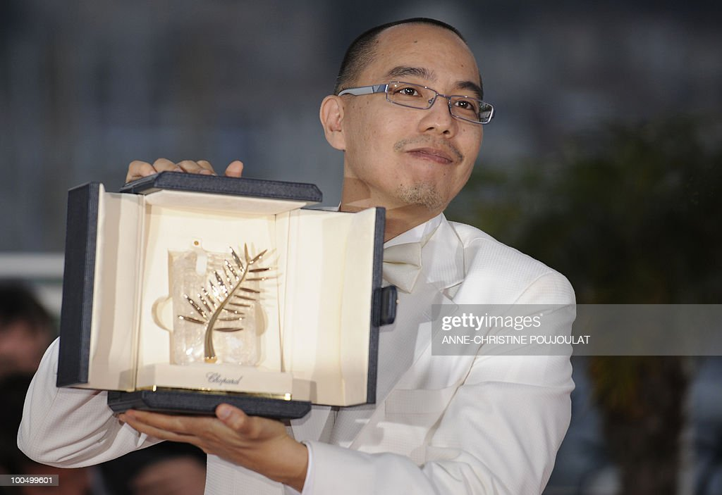 Thai director Apichatpong Weerasethakul poses after receiving the Palme d�Or award for his film 'Lung Boonmee Raluek Chat' (Uncle Boonmee Who Can Recall His Past Lives) during the closing ceremony at the 63rd Cannes Film Festival on May 23, 2010 in Cannes.