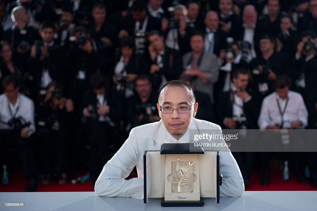 Thai director Apichatpong Weerasethakul poses after receiving the Palm d�Or award for his film 'Lung Boonmee Raluek Chat' (Uncle Boonmee Who Can Recall His Past Lives) during the photocall of the closing ceremony at the 63rd Cannes Film Festival on May 23, 2010 in Cannes.