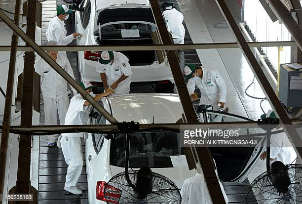 Thai employees work at a Japan's car manufacturer Honda production line after its reopening in Ayutthaya province on March 31 2012 The monthslong...