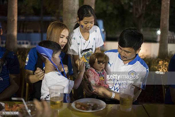 Thai family takes care of their doll before watching Leicester City plays against Manchester United on May 1 2016 in Bangkok Thailand Leicester City...