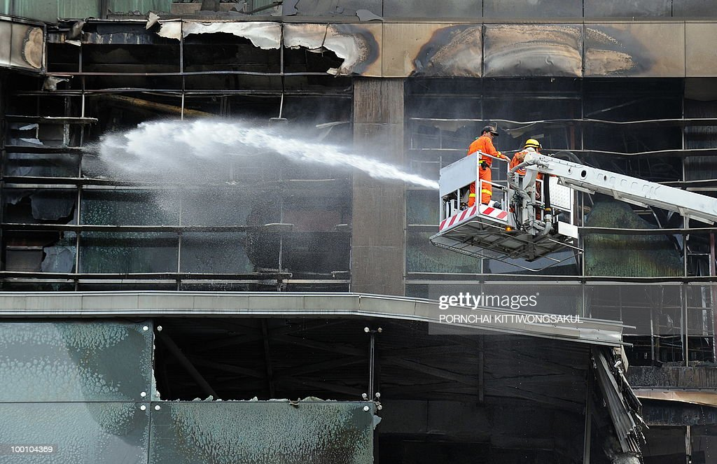 Thai firemen spray water on Thailand's biggest shopping mall - Central World - after it was set ablaze from anti-government protesters in Bangkok on May 21, 2010. Thailand picked up the pieces after violence and mayhem triggered by a crackdown on anti-government protests, as the focus swung to recovery and reconciliation in a divided nation.