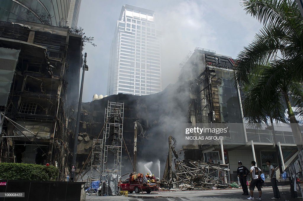 Thai firemen spray water onto the site of a fire at Thailand's biggest shopping mall - Central World - after it was set ablaze the day before following an army assault on an anti-government protest site in downtown Bangkok on May 20, 2010. Thailand's biggest shopping mall faces collapse after it was set ablaze by enraged protesters in the wake of an army offensive to shut down an anti-government rally, police said. AFP PHOTO/ Nicolas ASFOURI