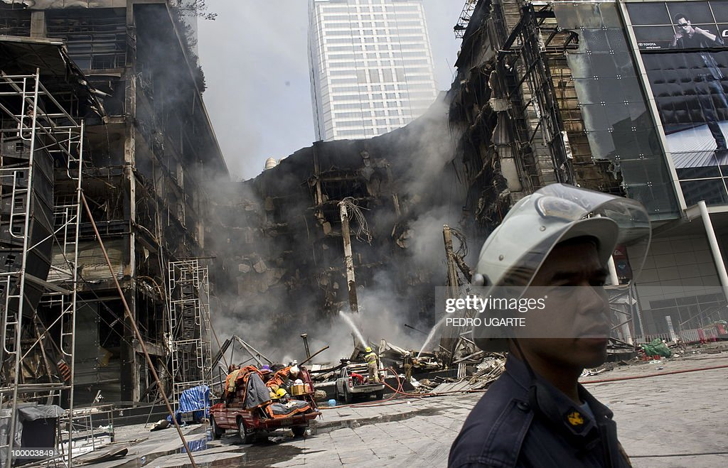 Thai firemen spray water onto the site of a fire at Thailand's biggest shopping mall - Central World - after it was set ablaze the day before following an army assault on an anti-government protest site in downtown Bangkok on May 20, 2010. Thailand's biggest shopping mall faces collapse after it was set ablaze by enraged protesters in the wake of an army offensive to shut down an anti-government rally, police said.