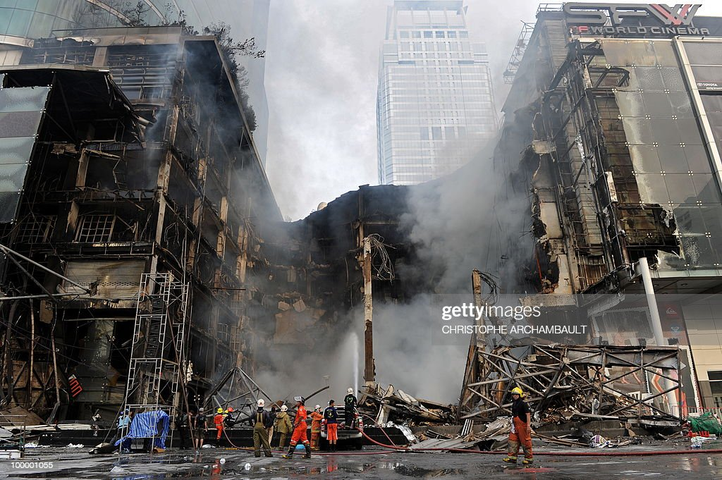 Thai firemen try to put douse the flames at Thailand's biggest shopping mall - Central World - after it was set ablaze the day before following an army assault on an anti-government protest site in downtown Bangkok on May 20, 2010. Thailand's biggest shopping mall faces collapse after it was set ablaze by enraged protesters in the wake of an army offensive to shut down an anti-government rally, police said. AFP PHOTO/Christophe ARCHAMBAULT
