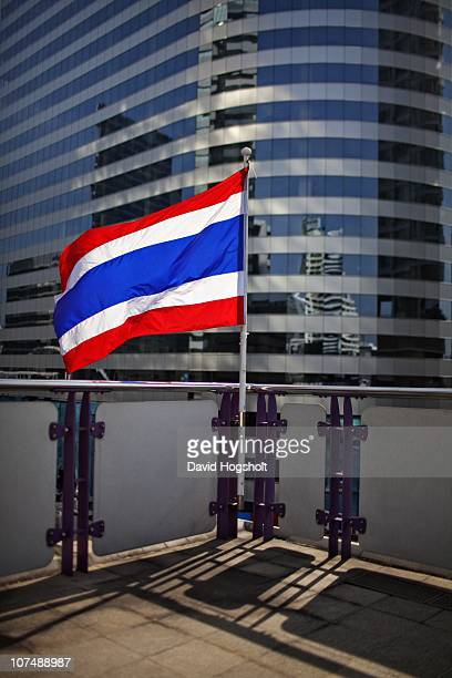 Thai flag moves in the wind on Chong Nonsi BTS station December 3 2010 in Bangkok Thailand The BTS also known as the Skytrain is Bangkok's premier...