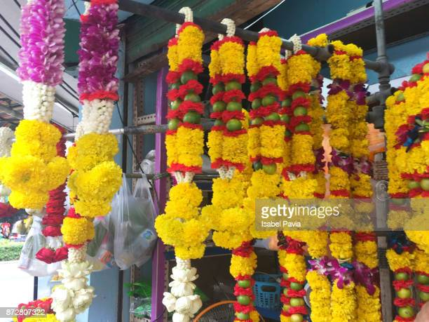 Thai floral garlands for religious offering on display at a flower market, Bangkok, Thailand