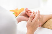 A customer receiving a Thai foot massage with reflexology and aroma therapy.