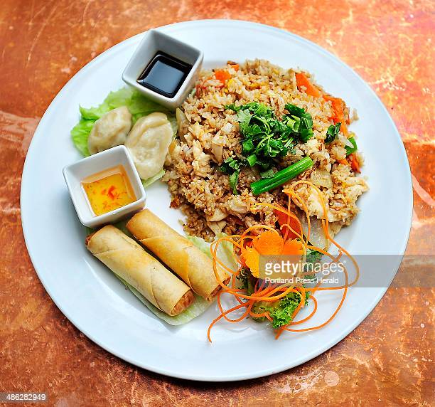 Thai Fried Rice lunch special with chicken egg carrot onion and scallion with sides of dumplings and vegetable egg rolls at Chaba Thai Cuisine...