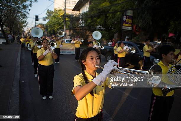 Thai girl plays trumpet during a parade in honor of the King's birthday on December 3 2014 in Chiang Mai Thailand December 5th marks the 87th...