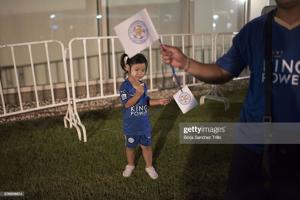 A Thai girls waves a Leicester City flag before watching her team plays against Manchester United at King Power Hotel on May 1, 2016 in Bangkok, Thailand.