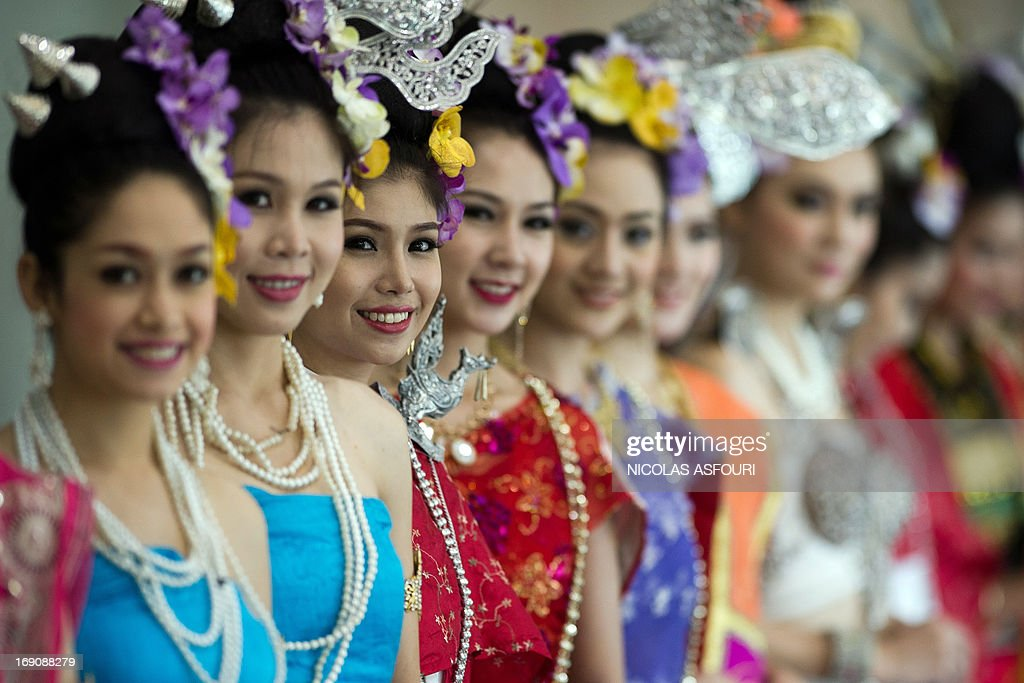 Thai hostesses in traditional costumes welcomes heads of delegations at the 2nd Asia-Pacific water summit in Chiang Mai on May 20, 2013. Asia's flood-prone megacities should fund major drainage, water recycling and waste reduction projects to stem deluges and secure clean supply for their booming populations, experts said. AFP PHOTO/ Nicolas ASFOURI