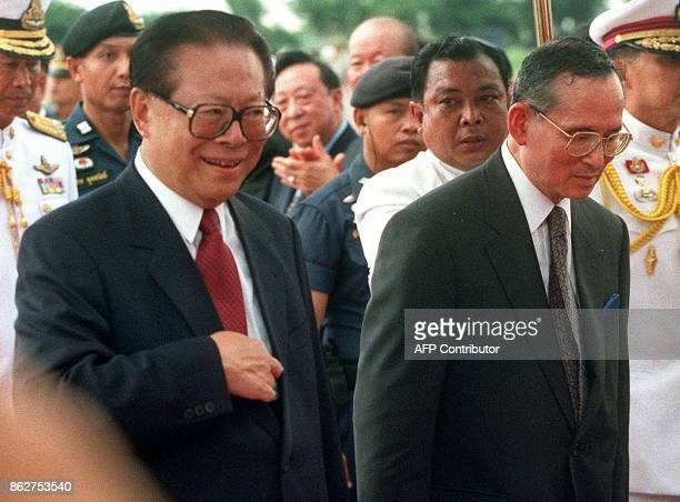 Thai King Bhumibol Adulyadej accompanies visiting Chinese President Jiang Zemin to the official welcoming ceremony 02 September 1999 at the Military...