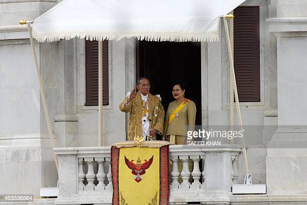 Thai King Bhumibol Adulyadej along with Queen Sirikit waves to his people in Bangkok 09 June 2006 Thai King Bhumibol Adulyadej called for unity among...