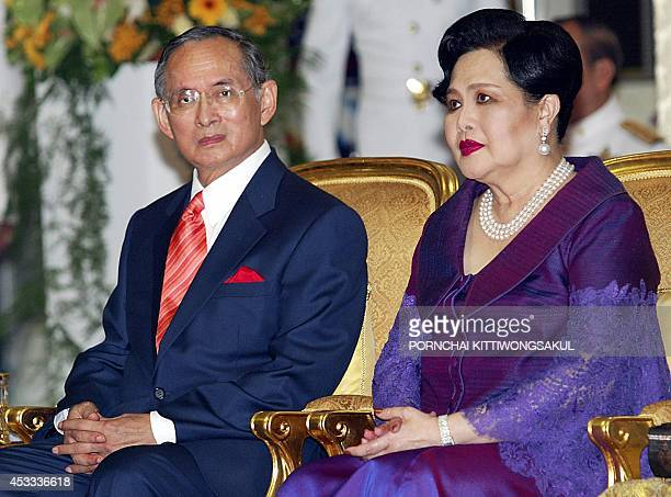 Thai King Bhumibol Adulyadej and Queen Sirikit attend the opening ceremony of Metro system in Bangkok 03 July 2004 Bangkok's new line built through a...