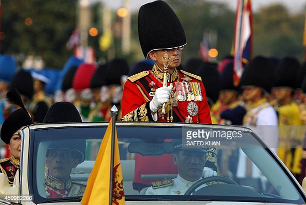Thai King Bhumibol Adulyadej and Queen Sirikit review the honor guard as a part of the celebration to commemorate his 80th birthday at the Royal...