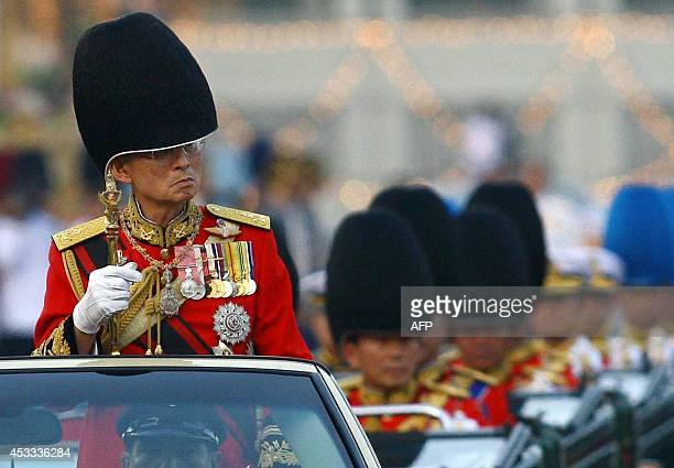 Thai King Bhumibol Adulyadej reviews the honor guard as a part of the celebration to commemorate his 79th birthday at the Royal Plaza in Bangkok 02...