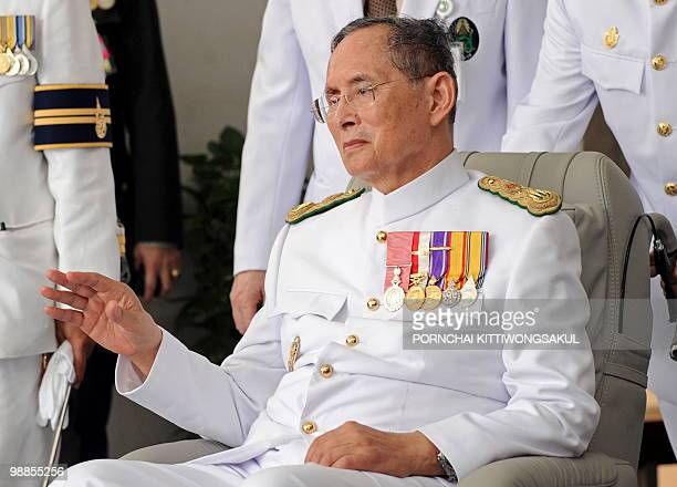 Thai King Bhumibol Adulyadej waves to a crowd of wellwishers as he marks the 60th anniversary of his coronation in Bangkok on May 5 2010 The...