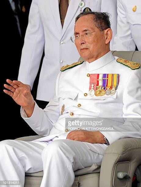 Thai King Bhumibol Adulyadej waves to a crowd of wellwishers to mark the 60th anniversary of his coronation in Bangkok on May 5 2010 The 82yearold...
