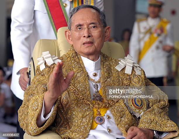 Thai King Bhumibol Adulyadej waves to wellwishers after the royal ceremony for his 83rd birthday in Bangkok on December 5 2010 the Thai king is the...