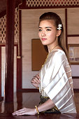 Thai lady in vintage original thailand attire, pray for something, god bless, waiting for something