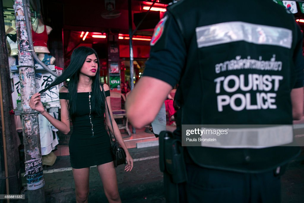 Thai ladyboy is round up by police during a nightly sweep in the red light district September 21 2014 in Pattaya Thailand Pattaya is tackling sex...
