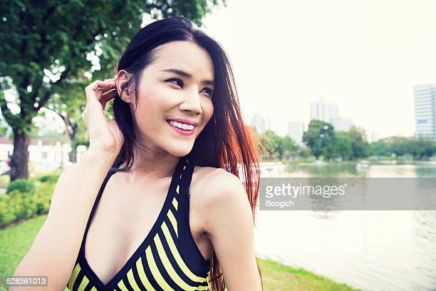 Thai Ladyboy Runner Takes Break in Lumpini Park Bangkok