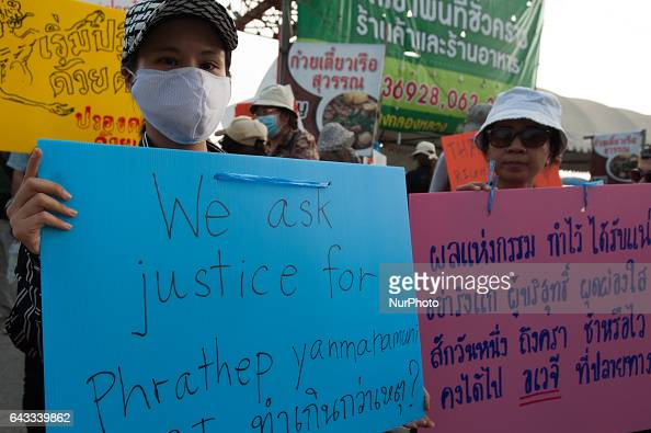 Thai laymen of the Dhammakaya Temple hold banners and chant after a scuffle with police officers outside the temple in Pathum Thani province on the...