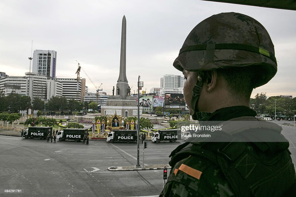 A Thai military officer looks down on the quiet streets surrounding the Victory Monument that were blocked off from all traffic in order to stop the anti-coup protesters on May 29, 2014 in Bangkok, Thailand. Thai military rulers have warned Thai citizens about expressing dissent using social media. Thailand is known as a country with a very unstable political record and is now experiencing it's 12th coup with 7 attempted pervious coups.