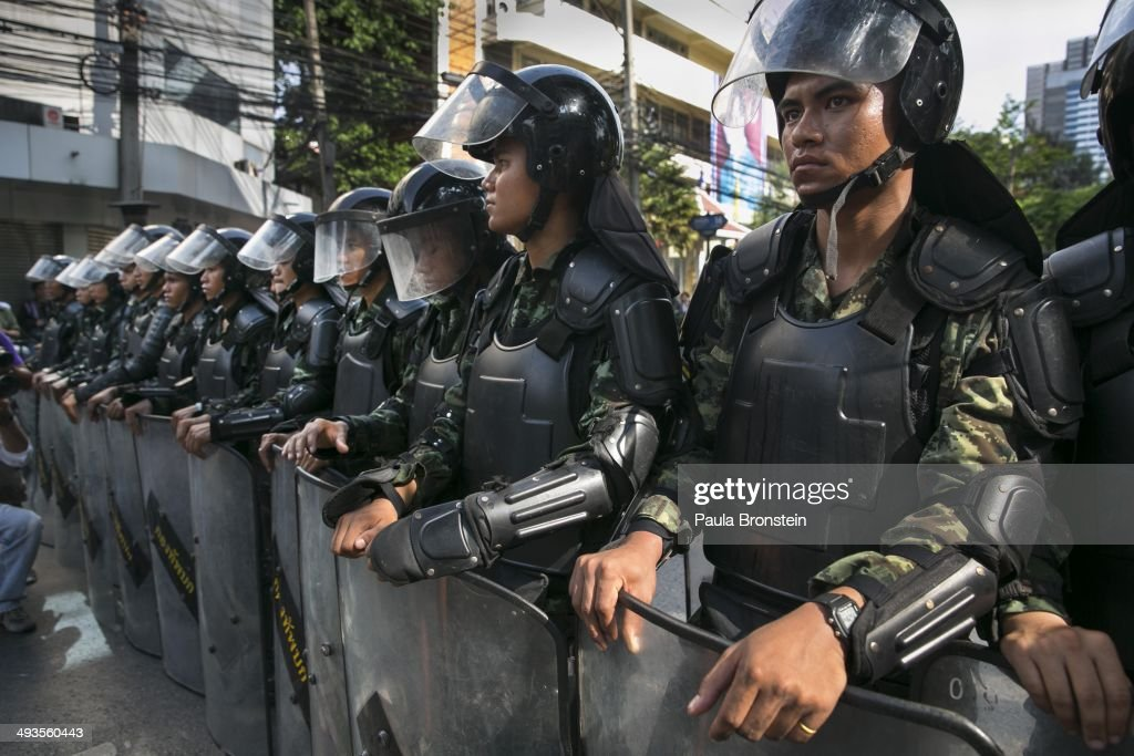Thai military wear riot shields as tensions increase during an anti-coup protest on the second day of Thailand's military coup May 24, 2014 in Bangkok, Thailand. Thailand's coup leaders they will continue to detain former Prime Minister Yingluck Shinawatra, along with Cabinet members and other anti-government protest leaders for up to a week. Thailand has seen many months of political unrest and violence which has claimed at least 28 lives. Thailand is now experiencing it's twelfth coup with seven attempted previous coups.