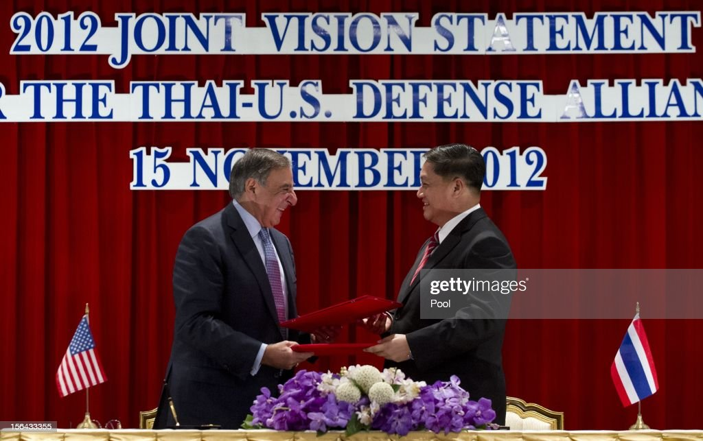 Thai Minister of Defense Sukampol Suwannathat (R) and US Secretary of Defense Leon Panetta shake hands after signing the 2012 Joint Vision Statement for the Thai - US Defense Alliance during a joint press conference following meetings at the Ministry of Defense on November 15, 2012 in Bangkok, Thailand. Panetta is in Thailand as part of an Asian tour ahead of US President Barack Obama's impending visit to the region.