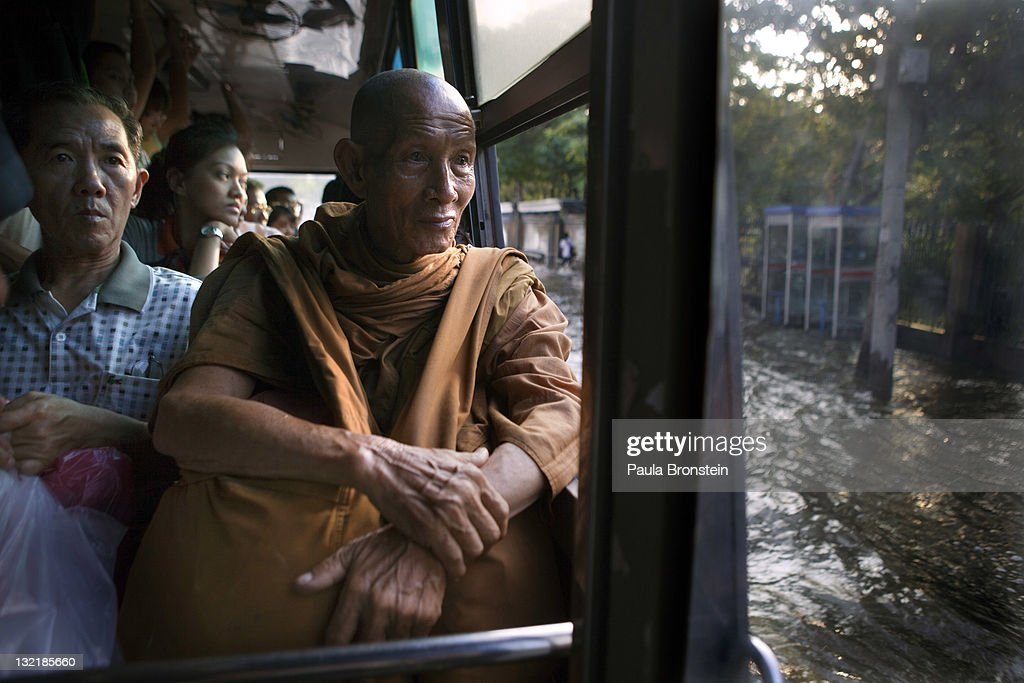 A Thai monk rides a city bus through the flooded streets in the downtown area of Mo Chit November 10, 2011 in Bangkok, Thailand. Over seven major industrial parks in Bangkok and, thousands of factories have been closed in the central Thai province of Ayutthaya and Nonthaburi with millions of tons of rice damaged. Across the country, the flooding which is now in its third month has affected 25 of Thailand's 64 provinces. Thailand is experiencing the worst flooding in over 50 years which has affected more than nine million people. Over 400 people have died in flood-related incidents since late July according to the Department of Disaster Prevention and Mitigation.