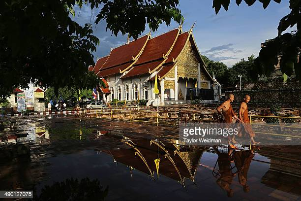 Thai monks at Wat Chedi Luang set out candle stands in preparation for evening ceremonies commemorating Visak Day on May 13 2014 in Chiang Mai...