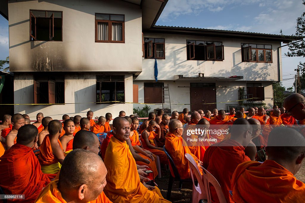 Thai monks gather outside the school dormitory for a prayer where a fire broke out on Sunday night killing at least 17 girls in Wiang Papao, Chiang Rai province May 24, 2016. The Pitakkiat Wittaya school was home to pupils from impoverished local hill tribes in the region, they were aged between 5 to 13. Based on reports, many of the 38 students were asleep when the fire swept through the elementary school in Chiang Rai Province and investigations are still being carried out to find the cause of the fire.