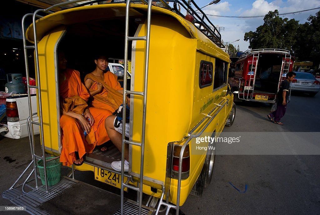 Thai monks on the Taxi on November 25, 2012 in Chiang Mai, Thailand. Chiang Mai is the largest and most culturally significant city in northern Thailand. It's a former capital of the Kingdom of Lanna (1296-1768) and was the tributary Kingdom of Chiang Mai from 1774 until 1939. In recent years, is has become an increasingly modern city and has been attracting over 5 million visitors each year, of which between 1.4 million and 2 million are foreign tourists.