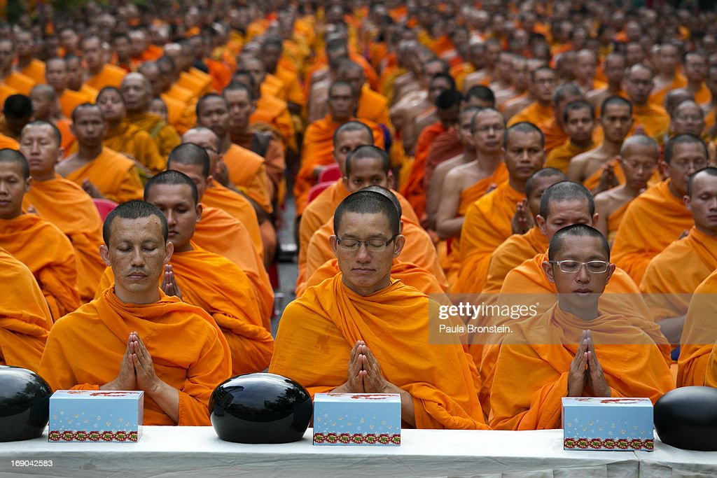 Thai monks pray as thousands of Thai monks gather on Visakha Bucha day in downtown Bangkok May 19, 2013. Visakha Bucha day is one of the most important days in the Buddhism calendar, every year monks gather to worship while many religious ceremonies occur during the week. Buddhism in Thailand is mostly of the Theravada school.