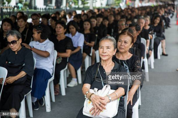 Thai mourners sit at the ceremonial ground for King Bhumibol Adulyadej at Sanam Luang park in Bangkok Thailand on Friday Sept 8 2017 The Kingdom of...
