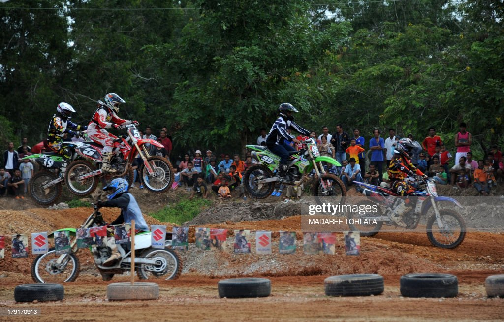 Thai muslim villagers attend a motorcross race between Thailand and Malaysia in Thailand's restive southern province of Narathiwat on September 01, 2013. Thailand and Malaysia motorcross races is one of the efforts to strengthen the relationship between the two countries.