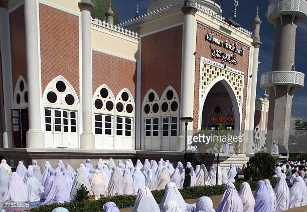 Thai Muslim women offer Eid alFitr prayer at the end of the fasting holy month of Ramadan at Pattani Grand Mosque in Thailand's southern Pattani...