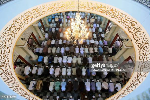 Thai Muslims pray at the Pattani Central Mosque to mark the holy month of Ramadan in Pattani on June 19 2015 More than 15 billion Muslims around the...