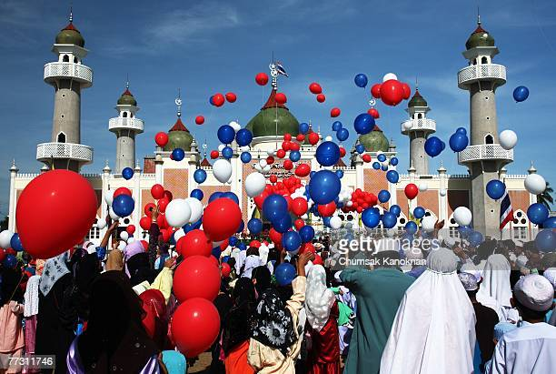 Thai Muslims release hundred of balloons after a morning prayer marking the start of the Islamic feast of Eid alfitr outside Pattani mosque on...