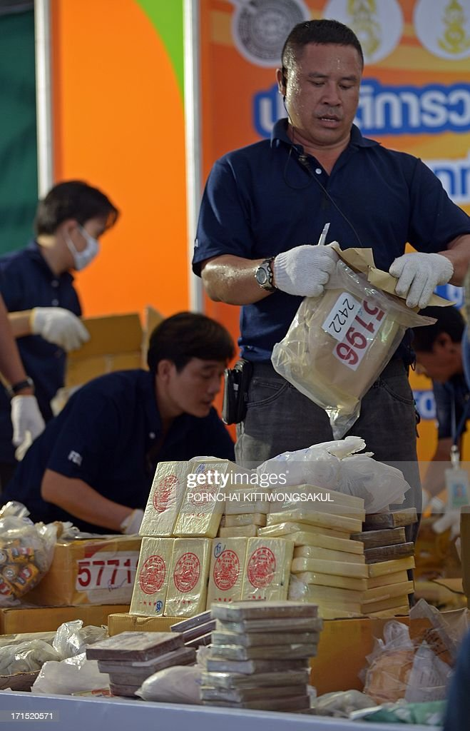 Thai officials unpack confiscated narcotics before destroying them marking the UN's International Day Against Drug Abuse and Illicit Trafficking in Ayutthaya province on June 26, 2013. More than 3363 kilograms of confiscated narcotics including methaphetamine, heroin, opium, cocaine and psychotropic substances with an estimated value of 10 billion bahts (324 million USD) were to be burnt.