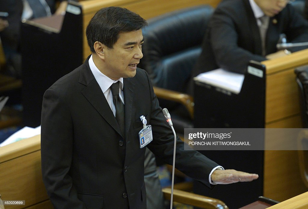Thai opposition leader <a gi-track='captionPersonalityLinkClicked' href=/galleries/search?phrase=Abhisit+Vejjajiva&family=editorial&specificpeople=645779 ng-click='$event.stopPropagation()'>Abhisit Vejjajiva</a> speaks during a no-confidence debate in the parliament in Bangkok on November 26, 2013. Thailand's premier appealed for an end to 'mob rule' as she prepared to face a no-confidence debate in parliament after protesters occupied key ministries in a bid to topple her government. AFP PHOTO / PORNCHAI KITTIWONGSAKUL