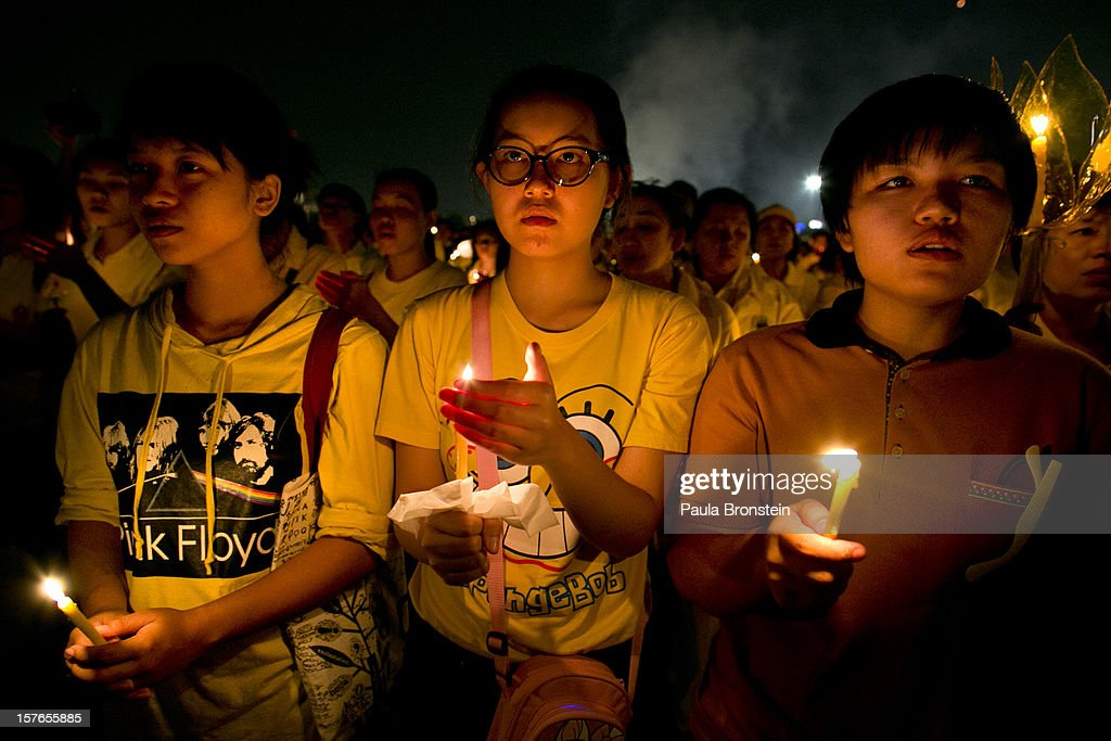 Thai people hold candles during celebrations to pay respect to Thailand's King Bhumibol Adulyadej on his 85th birthday December 5, 2012 in Bangkok, Thailand. King Bhumibol took the throne in 1946, making him the world's longest reigning monarch and the world's longest serving head of state. Yellow represents Monday, the birthday of the King.