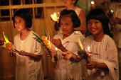 Thai people holding candles during Asalha Puja Day celebration Thai culture or Asalha Puja Day celebrates the first teaching of Buddha Asalha is also...