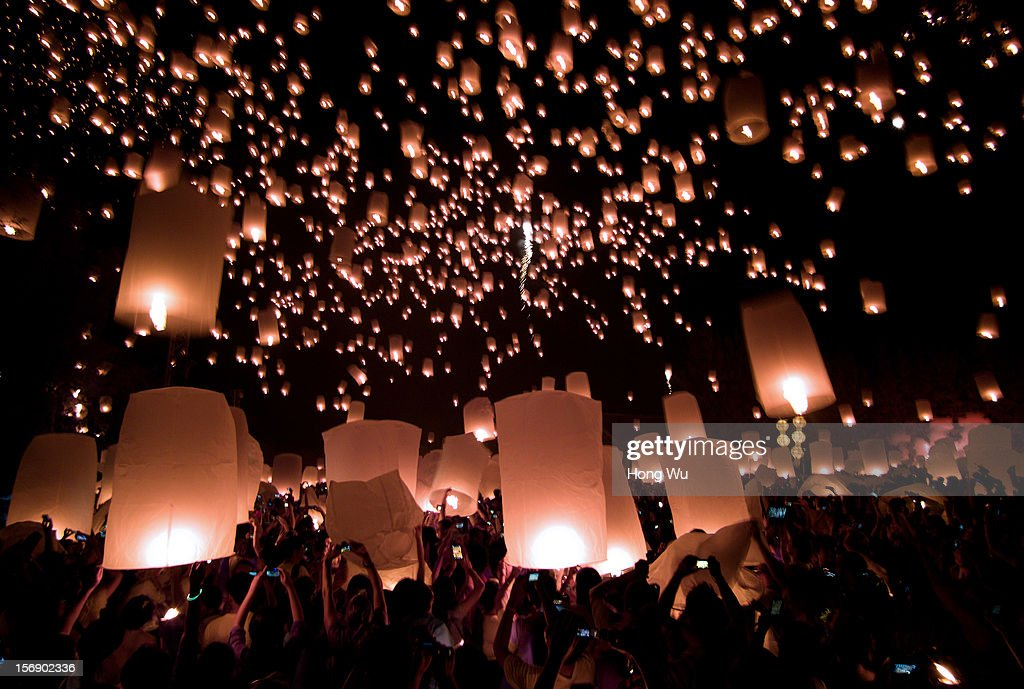 Thai people launch khom loi (sky lanterns) into the night sky during the Yi Peng Festival on November 24, 2012 in Chiang Mai, Thailand. The Yi Peng Festival is a traditional festival held ahead of the Loy Krathong Festival, which celebrates the full moon of the 12th lunar month in the Buddhist calendar. During the festival floating lanterns are launched into the night sky in the belief that grief and misfortune will fly away with the lanterns.