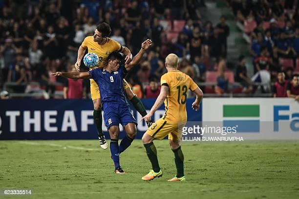 Thai player Sirod Chattong battles for a header against Australian player Milos Degenek during the 2018 World Cup football qualifying match between...