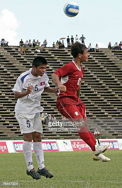 Thai player Souk A Phone Vongchiengkham and Laos player Suphanon Prangchan jump for the ball in the final of the ASEAN Football Federation U17...